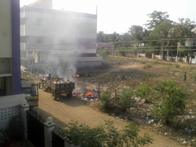 Garbabge and plastic burned right in front of homes by Sithalapakkam Panchayat.